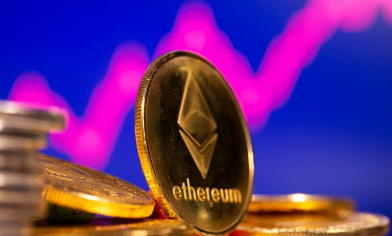 FILE PHOTO: A representation of virtual currency Ethereum are seen in front of a stock graph in this illustration